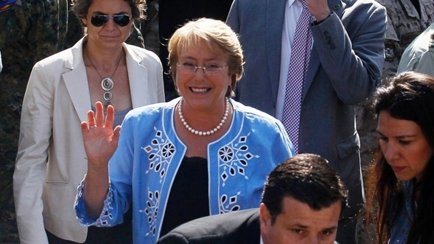 Dec. 15, 2013: Presidential candidate and former President Michelle Bachelet waves to supporters after casting her vote during presidential elections in Santiago, Chile.