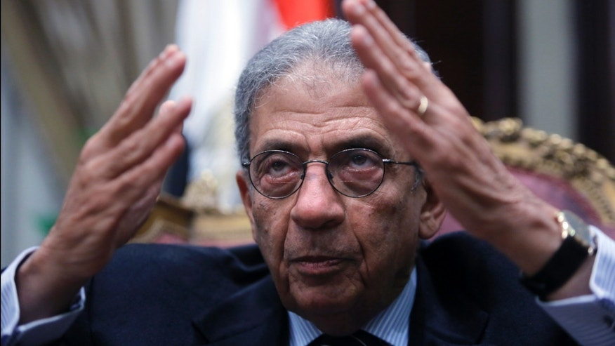 Amr Moussa, the chairman of Egypt's 50-member panel tasked with amending its Islamist-drafted constitution, talks during an interview with The Associated Press at the Shoura Council in Cairo, Egypt, Tuesday, Dec. 10, 2013. Egypt's veteran diplomat and liberal politician Moussa said a constitution drafted by a 50-member panel he chaired will offer unprecedented guarantees for democracy, individual freedoms and gender equality. (AP Photo/Amr Nabil)