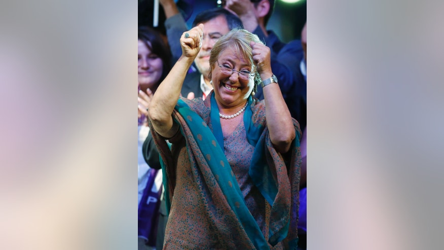 Presidential candidate and former President Michelle Bachelet waves during a victory rally in Santiago, Chile, Sunday, Dec. 15, 2013. With 90 percent of the votes counted, Bachelet had an unbeatable 62 percent to 38 percent for the center-right's Evelyn Matthei, who has conceded defeat. (AP Photo/Jorge Saenz)