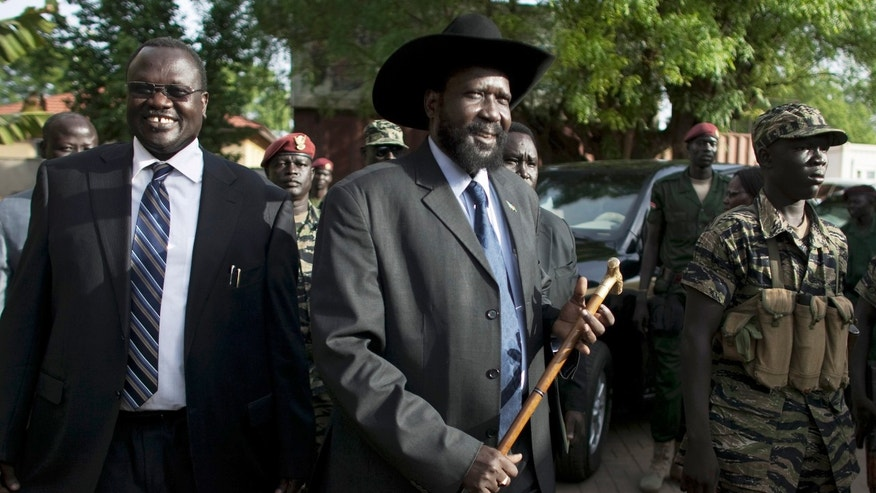 April 26, 2010 - FILE photo of former South Sudan Vice President Riek Machar, left, President of South Sudan Salva Kiir, arriving during a press conference in Juba, South Sudan. Soldiers loyal to a former vice president attempted to overthrow the government of South Sudan, the country's president said Monday, as sporadic fighting between factions of the military gripped the capital in the latest violence to hit the world's youngest nation.