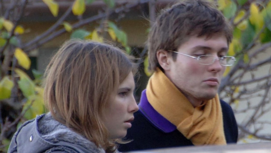 FILE - This Nov. 2, 2007 file photo shows American exchange student Amanda Knox, left, and her Italian boyfriend Raffaele Sollecito outside the rented house where 21-year-old British student Meredith Kercher was found dead in Perugia, Italy. Knox spent four years in jail in Italy, from her arrest to her conviction in her first murder trial through her successful appeal. She's now facing a second appeals trial, along with Sollecito. (AP Photo/Stefano Medici, File)