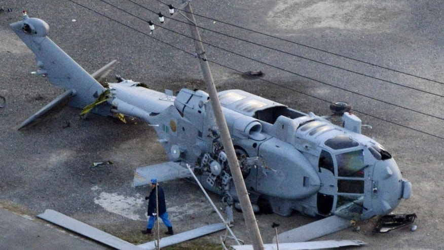 Dec. 16, 2013 - A U.S. Navy MH-60 helicopter lies on the ground after making an emergency landing in Miura city, near Tokyo. U.S. Forces Japan spokesman David Honchul said 2 injured crew members from the helicopter were taken to a hospital for treatment. (courtesy Kyodo News)
