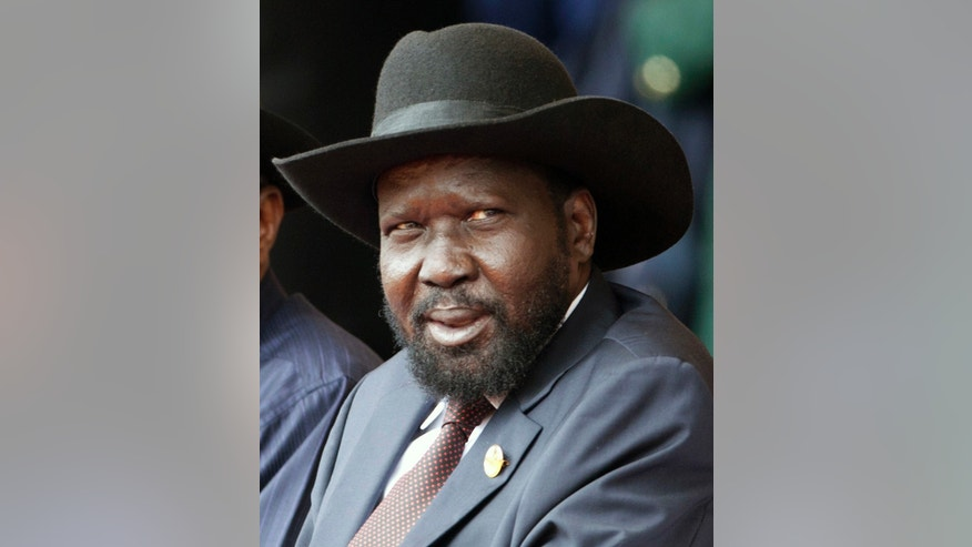 In this Thursday, Dec. 12, 2013 photo, South Sudan President Salva Kiir attends during a ceremony for Kenya's 50th independence anniversary in Nairobi, Kenya. Sporadic gunfire rang out early Monday, Dec. 16, 2013 in the South Sudan capital, Juba, in what a senior military official said were clashes between factions of the country's military. There has been political tension in the world's youngest nation since Kiir fired Riek Machar as his deputy in July. (AP Photo/Sayyid Azim)