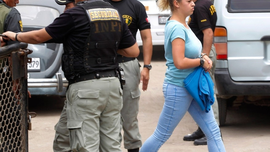 Melissa Reid arrives for her sentencing at a court in Callao, Peru, Tuesday, Dec. 17, 2013.  Reid, of Scotland, along with Michaella McCollum, of Ireland, were detained in August at Lima's airport for allegedly trying to smuggle cocaine on a flight to Spain and were formally charged for drug trafficking. (AP Photo/Martin Mejia)