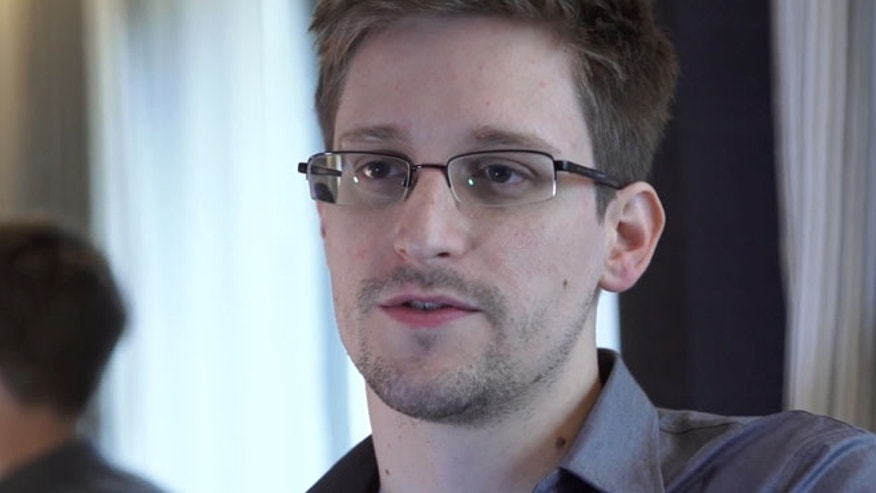 June 9, 2013: In this file photo provided by The Guardian Newspaper in London shows Edward Snowden, who worked as a contract employee at the National Security Agency, in Hong Kong.