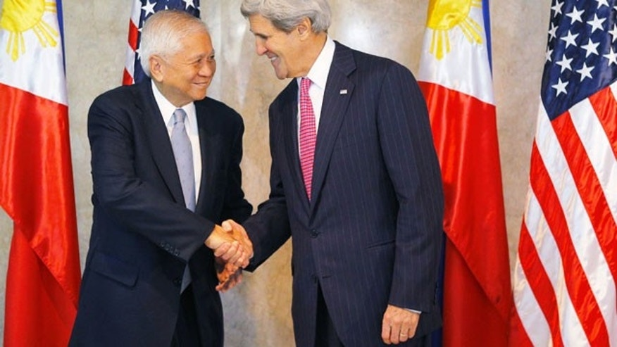 December 17, 2013: U.S. Secretary of State John Kerry, right, is greeted by Philippine Foreign Secretary Albert del Rosario for a meeting in Manila, Philippines. (AP Photo)