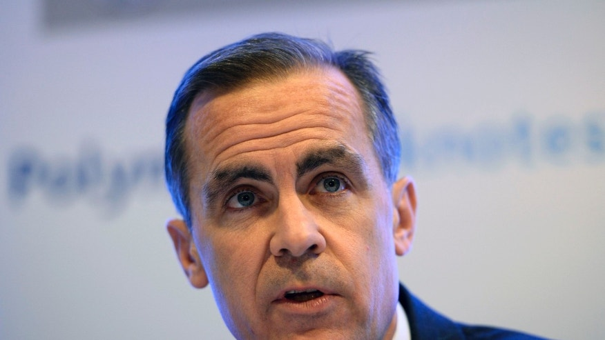 The Governor of Britain's Bank of England, Mark Carney, speaks at a news conference at the Bank of England, in the City of London, Wednesday, Dec. 18, 2013.  The news conference was held to announce the outcome of the polymer banknote consultation. (AP Photo/Dylan Martinez, Pool)