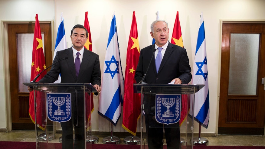 Israeli Prime Minister Benjamin Netanyahu, right, speaks during a press conference with Chinese Foreign Minister Wang Yi before their meeting at the prime minister's office in Jerusalem, Wednesday, Dec. 18, 2013. (AP Photo/Abir Sultan, Pool)