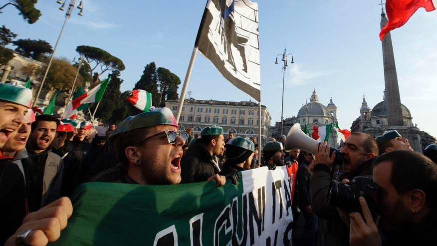 "Demonstrators gather in Piazza del Popolo square to protest against Government's austerity measures in Rome, Wednesday, Dec. 18, 2013. What started out as the so-called ""pitchforks protest"" by Sicilian farmers nearly two years ago is now a nationwide expression of citizen impatience over rising unemployment, stubborn recession and national lawmakers and government. (AP Photo/Gregorio Borgia)"