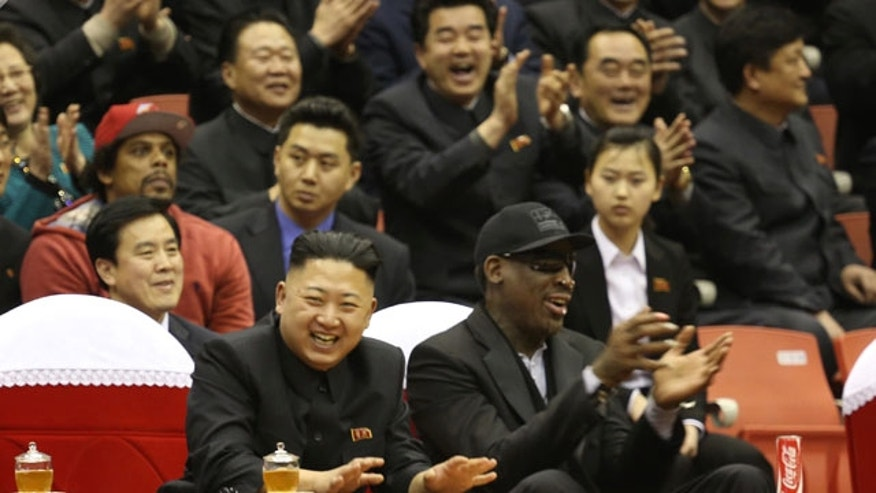 FILE - North Korean leader Kim Jong Un, left, and former NBA star Dennis Rodman watch North Korean and U.S. players in an exhibition basketball game at an arena in Pyongyang, North Korea, Thursday, Feb. 28, 2013. (AP Photo)