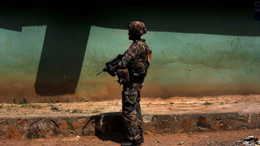 A French soldier patrols the Castor neighborhood of Bangui, Central African Republic, Monday Dec. 16, 2013. Over 1600 French troops have been deployed to the country in an effort to put an end to sectarian violence.  More than 600 people have been killed since Anti-Balaka launched a strike over Bangui last week before being pushed back. (AP Photo/Jerome Delay)