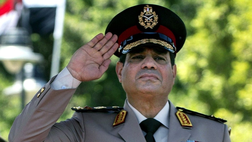 FILE - In this Wednesday, April 24, 2013 file photo, Egyptian Defense Minister Gen. Abdel-Fattah el-Sissi salutes during an arrival ceremony for U.S. Secretary of Defense Chuck Hagel at the Ministry of Defense in Cairo. In an audiotape, the military chief talks about his dreams, saying that in one nighttime vision he was brandishing a sword and that in another he told the late Anwar Sadat that he himself would be president one day. The tape, apparently leaked by opponents to embarrass the general, kicked off an online storm of parodies and mockery. But to most Egyptians, among whom dream interpretation is commonplace, it only deepened an image of the country's most powerful figure and very possibly its next president as a spiritual man, in touch with the nation's traditions. (AP Photo/Jim Watson, Pool, File)