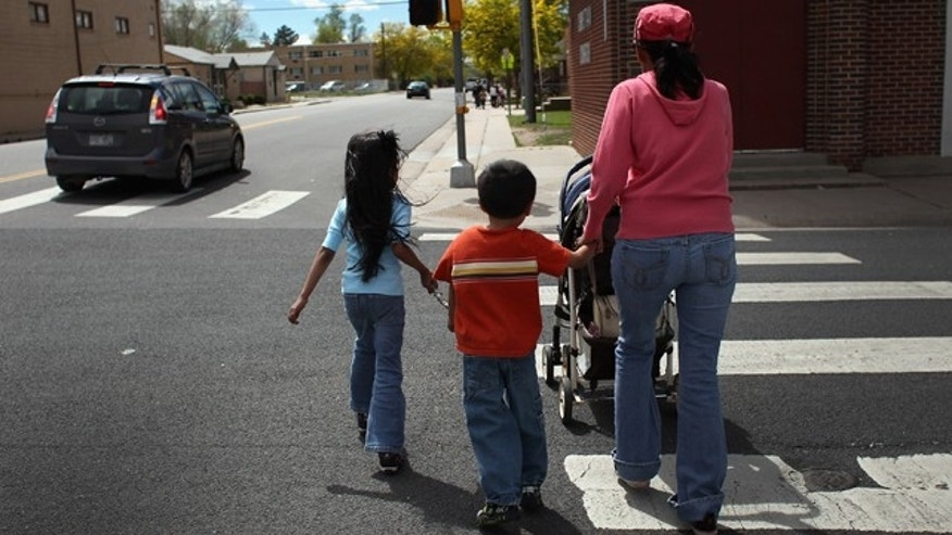 AURORA, CO - MAY 21:  Undocumented Mexican immigrant Jeanette Vizguerra walks home with her three American-born children on May 21, 2011 in Aurora, Colorado. Vizguerra is facing deportation to Mexico and is scheduled for a final hearing July 13 at Denver's Federal Courthouse. Just one of millions of undocumented immigrants living in the United States, Vizguerra first came to Colorado from Mexico City with her husband 14 years before. She is a small business owner of a janitorial service and a community organizer for immigration rights. Stopped two years ago by a traffic policemen for driving with expired tags, Vizguerra was taken to jail when she could not prove she was in the country legally. Out on bail during lengthy court proceedings, she now faces the real possibility that she will be deported back to Mexico and separated from her family in the United States.  (Photo by John Moore/Getty Images)