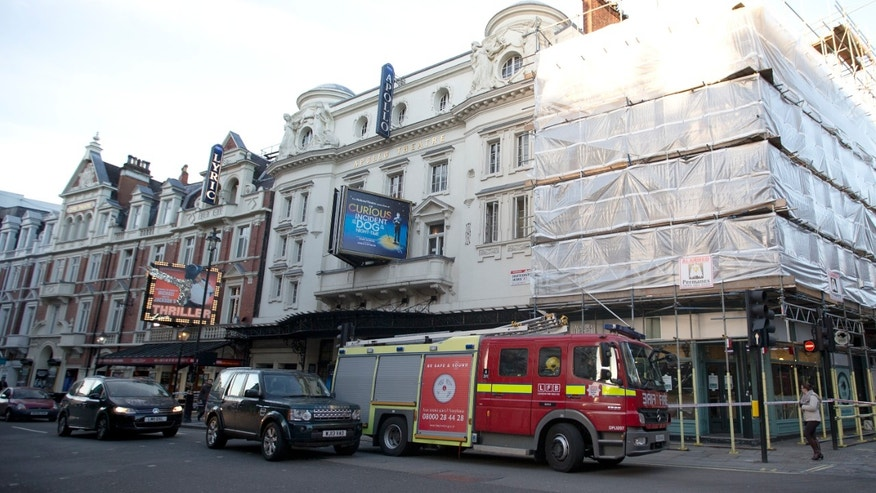 Dec. 20, 2013 - A fire brigade truck waits outside The Apollo Theatre in London. Authorities are carrying out a structural assessment at the Theatre after the partial collapse of its ceiling injured more than 75 people in the packed auditorium. An initial report is expected Friday after an overnight survey.