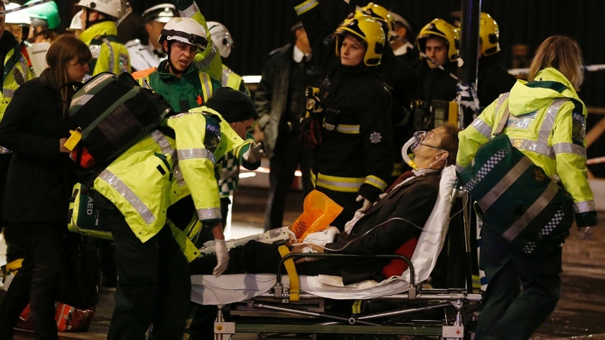 Dec. 19, 2013 - A man is wheeled out of a theatre used as a makeshift treatment center for the nearby Apollo Theatre after its ceiling collapsed, London. The ceiling of a London theatre partially collapsed, showering a packed audience of about 700 with heaps of plaster, wood and dust, authorities and witnesses said. More than 80 people were injured, including at least seven seriously, and several trapped theater-goers had to be rescued.
