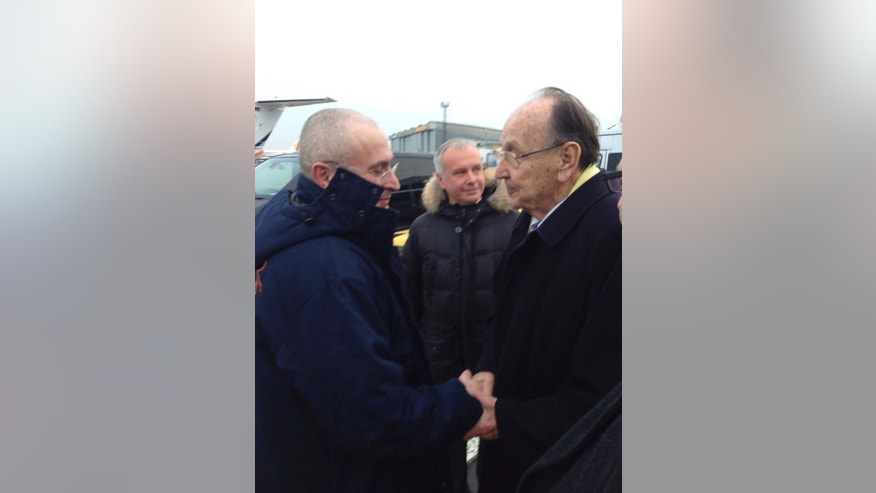 Photo provided by the owners of the website khodorkovsky.ru shows former German Foreign Minister Hans-Dietrich Genscher, right, welcoming Russian oligarch Mikhail Khodorkovsky at the airport in Berlin-Schoenefeld  Friday, Dec. 20, 2013. After spending 10 years in Russian jails for what many in the West believe were trumped-up offenses Khodorkovsky left prison a free man Friday and immediately flew to Germany. (AP Photo/khodorkovsky.ru) MANDATORY CREDIT