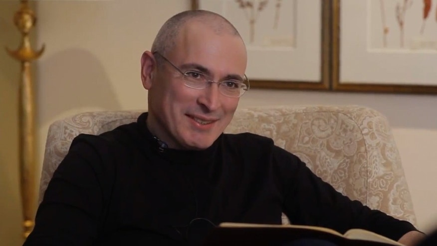 In this image made from video footage released by Newtimes.ru on Saturday, Dec. 21, 2013, Mikhail Khodorkovsky speaks during his first interview after his release with the editor in chief of the Russian weekly magazine 'Newtimes', Yevgenia Albats, in the hotel 'Adlon' in Berlin, Germany. The former oil baron Mikhail Khodorkovsky was reunited with his family in Berlin on Saturday, a day after being released from a decade-long imprisonment in Russia. Khodorkovsky, a prominent critic of Russian President Vladimir Putin, was meeting with his eldest son Pavel and his parents, Marina and Boris, who had flown separately to the German capital to meet him, said Christian Hanne, Khodorkovsky's spokesman. (AP Photo/Newtimes.ru) RUSSIA OUT