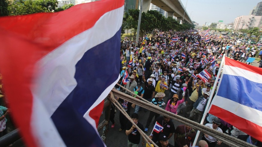 Thai anti-government protesters march Sunday, Dec. 22, 2013, in Bangkok, Thailand. Thailand's main opposition Democrat Party said it would boycott February's general election, deepening a political crisis as protesters called for another major rally Sunday to step up efforts to oust the government and force political reforms. (AP Photo/Sakchai Lalit)