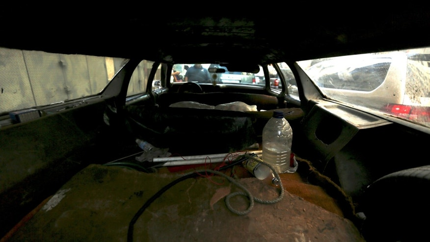 "This Thursday, Dec. 19, 2013 photo shows the back interior of Ruben Ruiz's station wagon at a taxi stand in Caracas, Venezuela. Ruiz is the proud owner of one a 1975 Ford LTD station wagon that he affectionately nicknamed his ""poverty spook,"" because the go-anywhere vehicle keeps him gainfully employed transporting everything from eight passengers at a time to crates of fresh fruit. Once his load even included a cadaver. (AP Photo/Fernando Llano)"