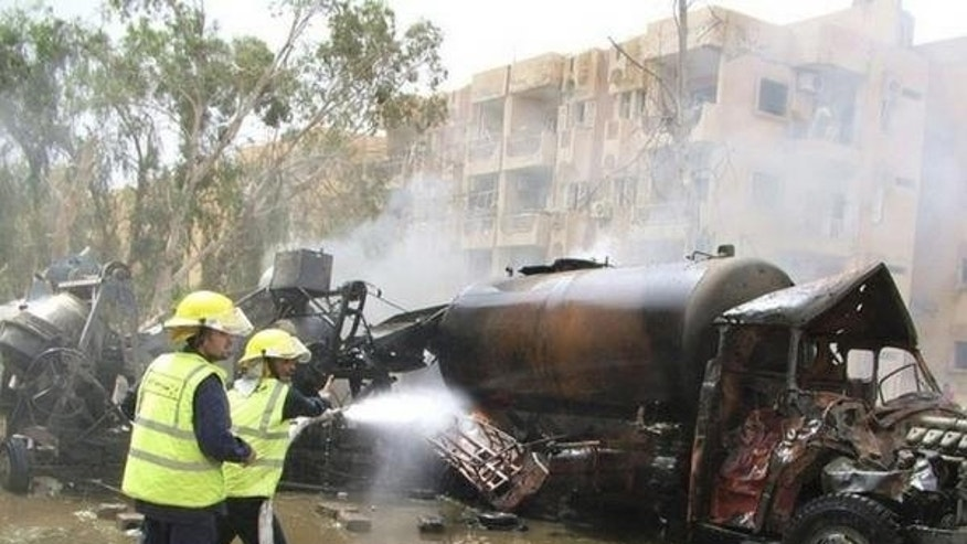 This August 2013 photo shows the charred remains of a water truck belonging to an Iraqi Christian who was kidnapped and killed. The truck had been loaded with explosives.