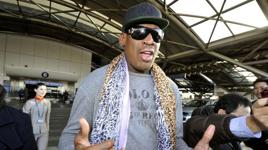 Dec. 23, 2013 - Former basketball star Dennis Rodman speaks to journalists upon arrival at the capital airport in Beijing from Pyongyang, North Korea. Rodman left North Korea Monday, but didn't answer questions on whether he met with leader Kim Jong Un on his latest visit.