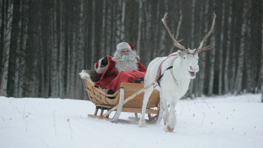 December 19,2007 - FILE photo of man dressed as Santa Claus riding his sleigh as he prepares for Christmas on the Arctic Circle in Rovaniemi, northern Finland.