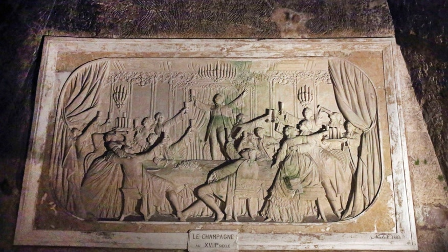 "FILE - In this Thursday, Oct. 17, 2013 file photo, a giant bas-relief engraved in a chalk plaque depicting an 18th century champagne celebration is seen in the Pommery cellars in Reims, eastern France. Without the widows of Champagne, mankind's most seductive fizz might well not be what it is now. One of the world's most famous Champagnes - Veuve (""Widow"") Clicquot -  explicitly evokes the rather grim tradition. But other legendary houses - Bollinger, Laurent-Perrier and Pommery - also got their starts from tragedy-tinged widows. Then there are the many lesser-known names that still carry the widow tag, such as Veuve Fourny and Veuve Doussot. (AP Photo/Remy de la Mauviniere, File)"