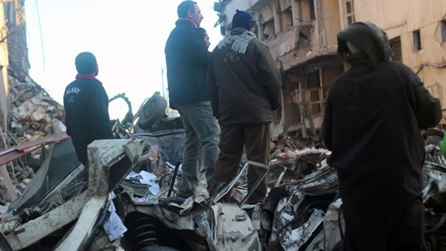 """December 24, 2013: Egyptians gather at the scene of an explosion at a police headquarters building that killed at least a dozen people, wounded more than 100, and left scores buried under the rubble, in the Nile Delta city of Mansoura, 70 miles north of Cairo. The country's interim government accused the Muslim Brotherhood of orchestrating the attack, branding it a """"terrorist organization."""""""