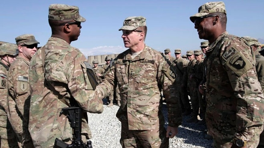 Dec. 24, 2013: U.S. Maj. Gen. James C. McConville, center, visits troops in Jalalabad, base east of Kabul, Afghanistan. The commander of NATO forces in eastern Afghanistan spent Christmas Eve visiting U.S. troops at bases across the mountainous region to bring them holiday greetings and gifts for a few lucky soldiers.