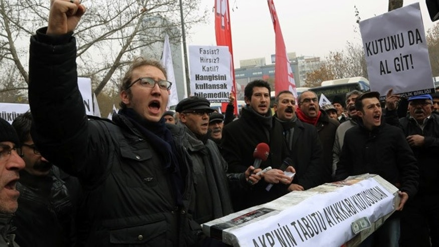 Dec. 21, 2013: People shout anti-government slogans as they carry a casket made of empty shoe boxes during a protest in Ankara, Turkey.