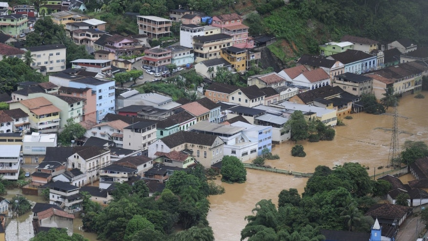 Aerial view of Santa Leopoldina municipality, flooded after heavy rains, in Espirito Santo state, Brazil, Wednesday, Dec. 25, 2013. Civil defense officials say the death toll in the floods and mudslides caused by heavy downpours in two states in southeastern Brazil has risen. More than 50,000 have been forced to leave their homes. (AP Photo/Vitor Jubino-A Gazeta)  **BRAZIL OUT**