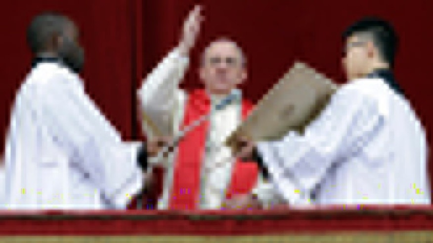 "Dec. 25, 2013: Pope Francis delivers his ""Urbi et Orbi"" (to the City and to the World) message from the central balcony of St. Peter's Basilica at the Vatican."