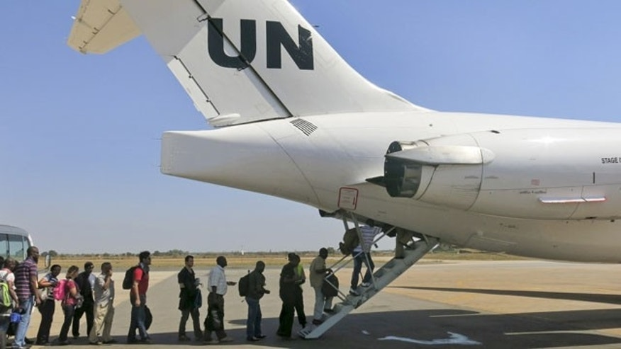 December 22, 2013: United Nations Mission In South Sudan relocates non-critical staff from Juba, South Sudan, to Entebbe, Uganda. Civilian helicopters evacuated U.S. citizens from the violent South Sudan city of Bor, capital of Jonglei state, seeing bouts of heavy machine gun fire, but 3,000 citizens from countries like Canada, Britain and Kenya remain trapped there, a top U.N. official said Monday. (AP Photo/UNMISS, Irene Scott)
