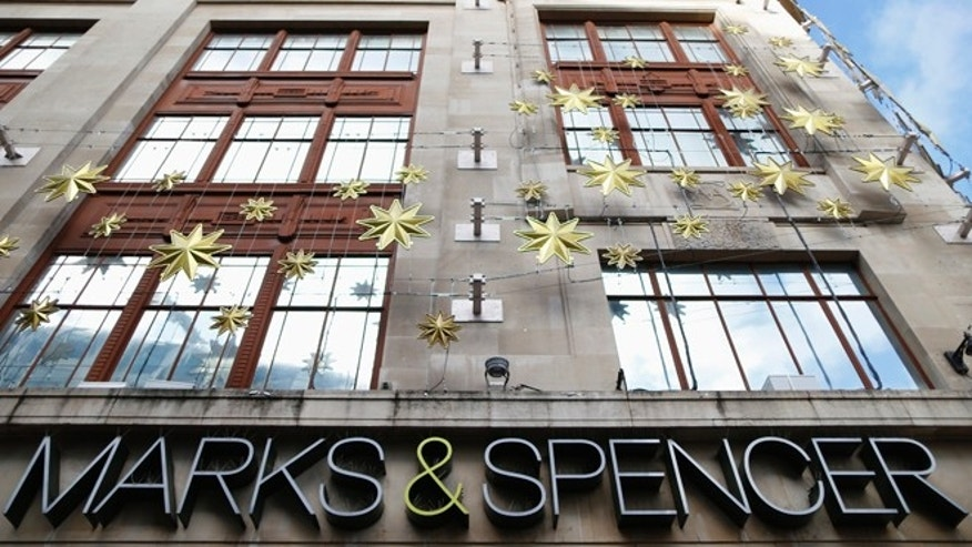 Nov. 5, 2013: Christmas decorations adorn the exterior of retailer Marks and Spencer's flagship store in London's West End.