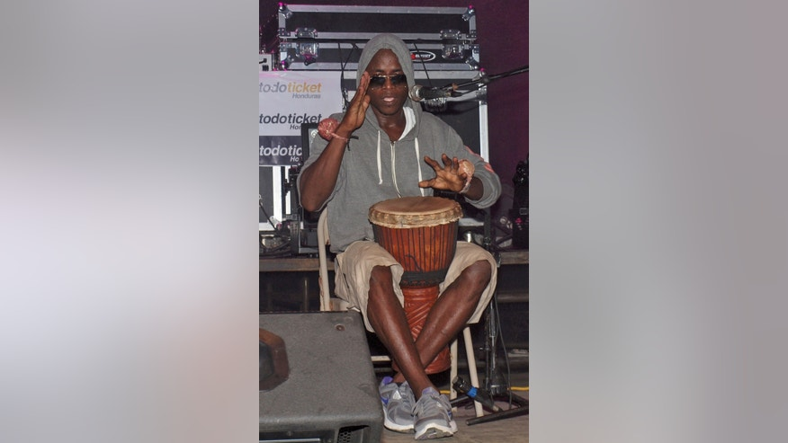 Aug. 31, 2013: In this photo, Lenin Roberto Arana, whose stage name is Canario, plays a traditional Garifuna drum during a concert in Roatan, Honduras.