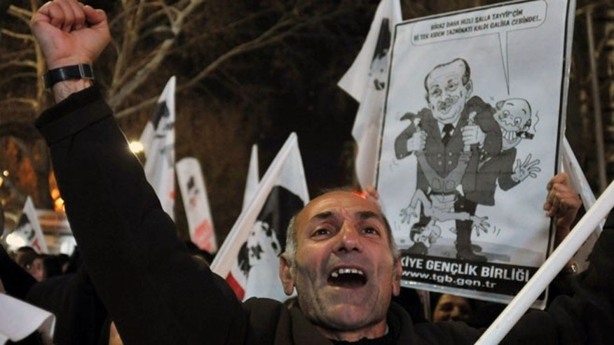 "Dec. 27, 2013: A protester shouts "" catch the thief!..""as several hundred  people call on the government to resign during a protest in Ankara, Turkey."