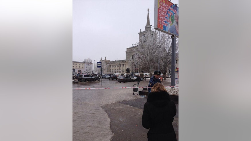 In this photo taken on a cell phone, made available by Volgograd Mayor's Office, a policeman stands by the cordoned off area of the Volgograd railway station, Sunday, Dec. 29, 2013. More then a dozen people were killed and scores were wounded Sunday by a suicide bomber at a railway station in southern Russia, officials said, heightening concern about terrorism ahead of February's Olympics in the Black Sea resort of Sochi. (AP Photo/Nikita Baryshev,Volgograd Mayor's Office Handout)