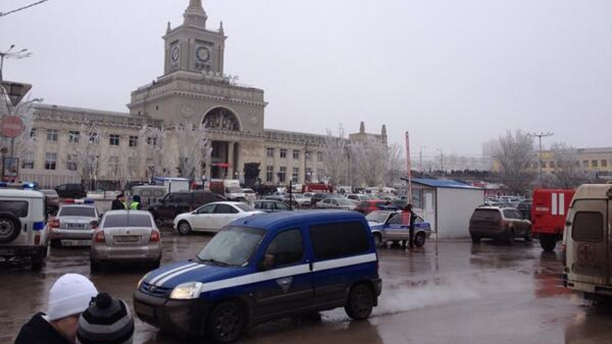 In this photo taken on a cell phone,  made available by Volgograd Mayor's Office, emergency services approach a square outside a main entrance of the Volgograd railway station, Sunday, Dec. 29, 2013. More then a dozen people were killed and scores were wounded Sunday by a suicide bomber at a railway station in southern Russia, officials said, heightening concern about terrorism ahead of February's Olympics in the Black Sea resort of Sochi. (AP Photo/Nikita Baryshev,Volgograd Mayor's Office Handout)