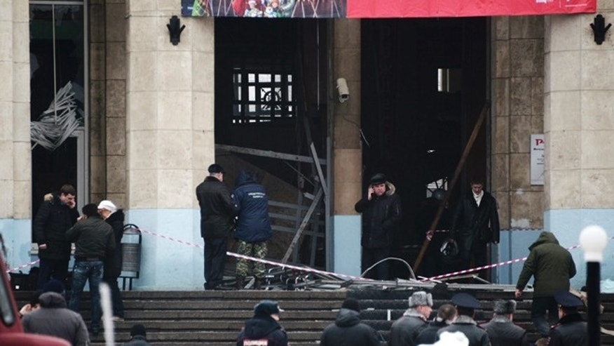Dec. 29, 2013: Investigators work at the site of an explosion at the entrance to a train station in Volgograd, Russia.