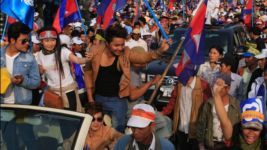 Supporters of opposition Cambodia National Rescue Party march on the main roads during their demonstration in Phnom Penh, Cambodia, Sunday, Dec. 29, 2013. In July, 2013 Prime Minister Hun Sen won elections that extended his 28-year rule in the poor Southeast Asia nation, but protesters led by the head of the opposition, Sam Rainsy, accuse him of rigging the vote. They have been staging street protests and demanding that he resign and call new elections. (AP Photo/Heng Sinith)