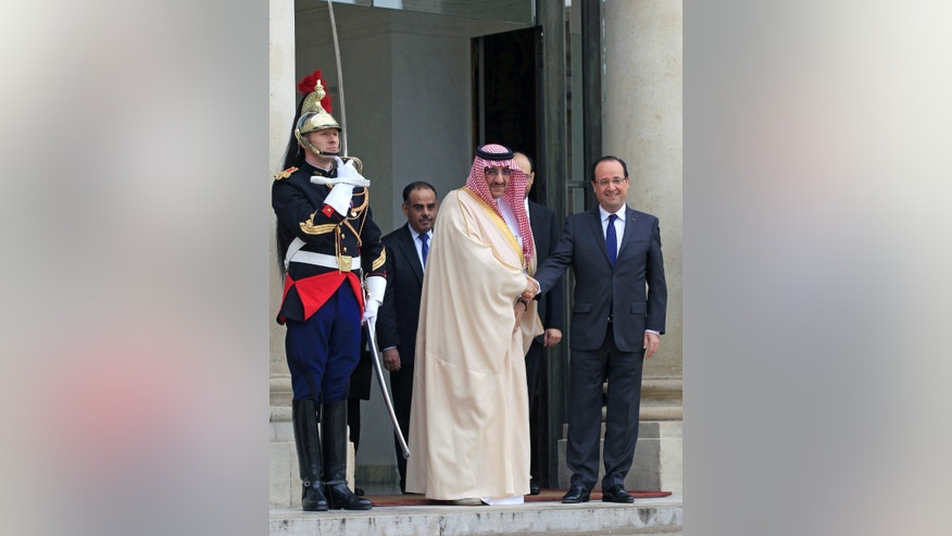 FILE-- In this Tuesday May 28, 2013 file photo, French President Francois Hollande, right, sees off Saudi Interior Minister Prince Mohamed bin Nayef following their meeting at the Elysee Palace, in Paris, France. Increasingly vocal in its frustration over the United States' Mideast policies, Saudi Arabia is strengthening ties elsewhere, seeking out an alignment that will bolster its position after it was pushed to the sidelines this year. It may find a solution in France, whose president is ending 2013 with 24 hours of high-level meetings with the Saudi leadership in a visit intended to showcase commercial and diplomatic strength. (AP Photo/Remy de la Mauviniere)