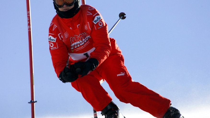 FILE: Ferrari driver Michael Schumacher of Germany speeds down a course in Madonna di Campiglio, Italy in 2006.