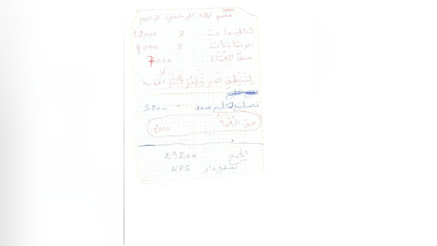 ADVANCE FOR USE MONDAY, DEC. 30, 2013 AND THEREAFTER - This receipt for house-cleaning equipment and labor, air conditioner repairs and security guards, which was retrieved from a building occupied by al-Qaida's North African branch in Timbuktu, Mali, is one of more than 100 receipts and invoices that show an organization intent on documenting even the most minor expenses. The al-Qaida fighters threw themselves into construction projects, making frequent trips to the hardware store to buy everything from bags of cement, to parts for a new shower, to tubes of superglue. (AP Photo)