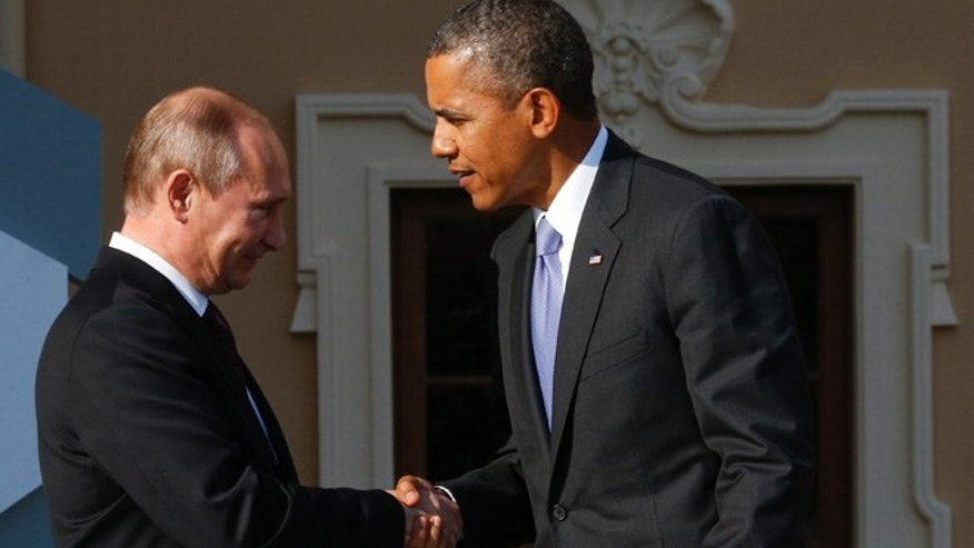 Sept. 5, 2013: Russia's President Vladimir Putin, left, welcomes President Obama before the first working session of the G20 Summit in Constantine Palace in Strelna near St. Petersburg, Russia.