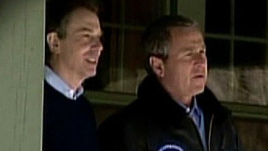 Former British Prime Minister Tony Blair and Former U.S. President George W. Bush
