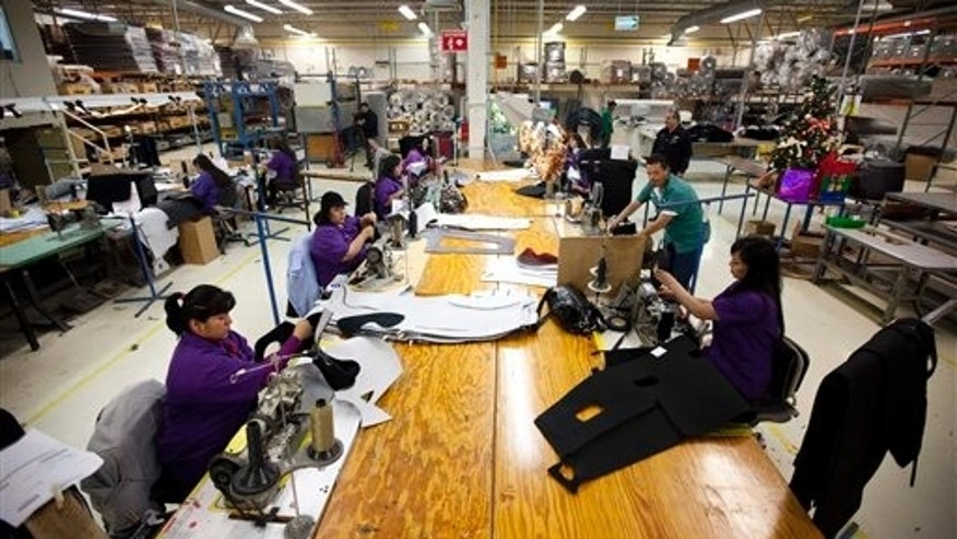 Workers manufacture car dash mats at a maquiladora in Ciudad Juarez, Mexico.