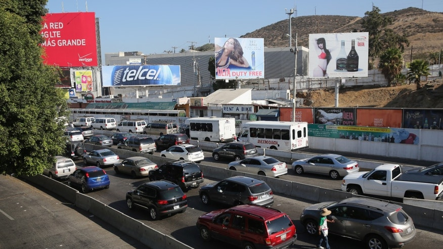 Traffic waits to cross the border into the United States on October 2, 2013 in Tijuana, Mexico.