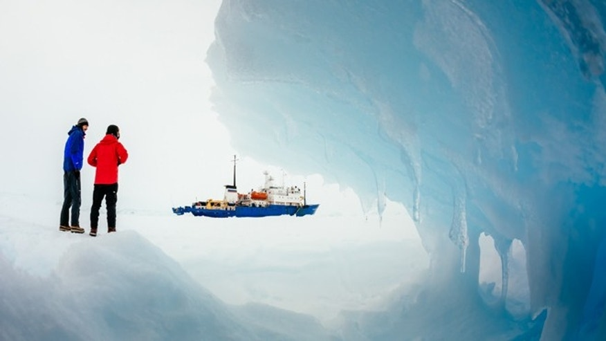 Passengers from the trapped Russian ship MV Akademik Shokalskiy walk around the ice, Dec. 31, 2013.