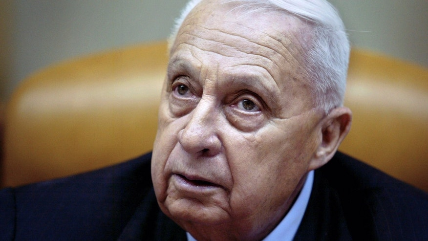 FILE -- In this Sunday Jan. 30, 2005 file photo, Israeli Prime Minister Ariel Sharon pauses during the weekly cabinet meeting in his Jerusalem office. Former Israeli Prime Minister Ariel Sharon, who has been in a coma for eight years, clings to life after a decline in the functioning of various bodily organs, his doctors say, Thursday, Jan. 2, 2014. (AP Photo/Oded Balilty, Pool, File)