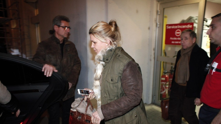 Michael Schumacher's wife, Corinna, leaves the Grenoble hospital, French Alps, Thursday, Jan. 2, 2014, where former seven-time Formula One champion Michael Schumacher is being treated after sustaining a head injury during a ski accident. Schumacher's condition is reported to be stable but still critical as he remained unconscious, his manager said Wednesday.  (AP Photo/Thibault Camus)